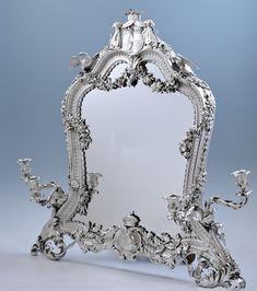 A Pash and Sons - Fine Antique Silver, Objet d'art, fine bronzes, & furniture A French silver dressing table mirror, Aucoc, Paris, circa 1840    Engraved Aucoc aine B'tier du Roi a Paris, contemporary Turin control marks  77cm., 30 1/4 in. high