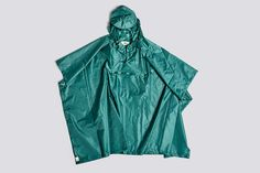 A new wet-weather friend, the Mono Rain Poncho is made of lightweight, water-resistant fabric and features a drawstring tie and peaked hood for superior protection. Its foldable design packs into the front pouch for easy transport. One size fits all. Rain Poncho, Design Bestseller, Design Within Reach, Wet Weather, Fulton, One Size Fits All, Raincoat, Green, Material
