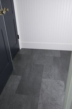 How to easily update a bathroom floor with luxury vinyl tile that looks like real stone! And why I chose luxury vinyl tile for our bathroom makeover. Vinyl flooring, vinyl plank flooring, vinyl flooring bathroom. #homeimprovement