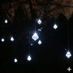 Like beautiful, glittering diamond jewelry for your yard, these Faceted Crystal Solar String Lights adorn trees, railings, or roof eaves with color and sparkle. A single strand contains ten molded acrylic, faceted, diamond-shaped ornaments, with individual hooks on continuous curtain wire. Powered by a high-efficiency solar panel, the durable lights will illuminate your outdoor space with long-lasting brilliance.