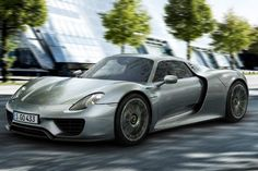 2015 Porsche 918 Spyder - MSRP from $845,000 -  The 4.6-liter V8 engine puts out 608 horsepower, with the combined powertrain output totaling 887 horsepower. Of course, Porsche wowed the world when it lapped the Nurburgring with the car in under seven minutes, showing that the 918 Spyder doesn't just look good, also performs like a champion.