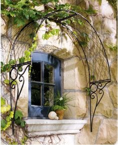 THIS is way cool . . . OVERDOOR ENGLISH TRELLIS : A lovely curved, wrought iron trellis to hang over a window or door Outdoor Wall Art, Outdoor Walls, Outdoor Spaces, Outdoor Living, Outdoor Decor, Indoor Outdoor, Iron Trellis, Wall Trellis, Vine Trellis