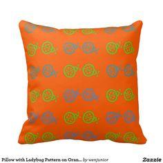 Pillow with Ladybug Pattern on Orange Background