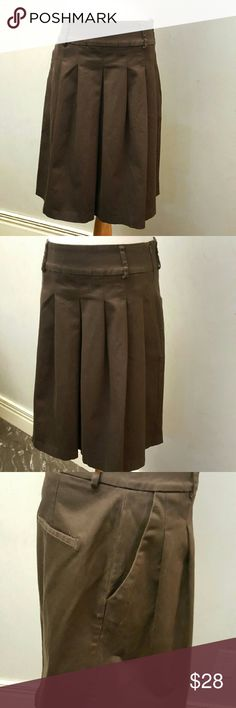 Zara basic brown skirt Zara basic brown skirt, gently used. Has some fade marks on the side and back. See pick 3 and 4 ... reasonable offers welcome. Zara Skirts Midi