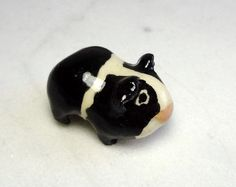 This listing is for one small black and white guinea pig with a pink nose. Here is 1 tiny guinea pig terrarium figurine. It is about half