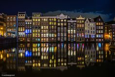 Amsterdam Damrak Amsterdam is very impressive with all its water canals and all these stunning houses located directly at the water. The atmosphere during the night is incomparable.  Single exposure - just basic development from raw  Sony A7 with Leica M Elmar 24mm