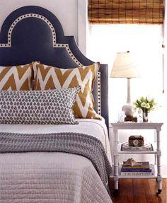 love this slate blue headboard and mustard yellow chevron pillow combo