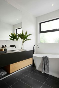 R U S H ➕ V I V I D S L I M L I N E We absolutely love the black, white and timber styling in this stunning ensuite in The Langham 44 house from ! This bathroom features our Rush Wall Set and Vivid Slimline Floor Mounted Bath Mixer, b