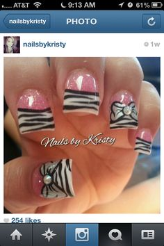 Pink Glitter/Zebra Tips ..I don't like the shape of the nails buht the design is cute