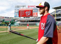 Washington Nationals left fielder Bryce Harper carries his bat to home plate , looking hot as hell....