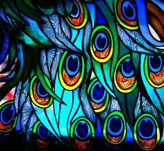 stained glass peacock feathers - consider color scheme, detail of larger work, artist unknown by zelma