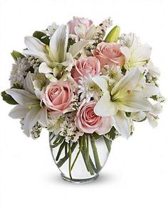 Light pink roses, white asiatic lilies, alstroemeria, cushion spray chrysanthemums and statice are delivered in a stylish vase. Style to spare! May also be ordered as a centerpiece.