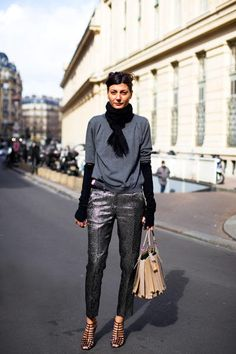 This woman has scaly silver pants and a giant signet ring with her name on it. Photo by Garance Dore