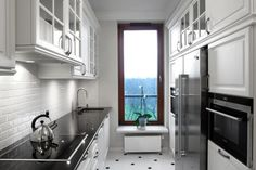 Art Deco For Kitchen Dominated With Bright And Dark Colors Such As  White Ceramic Floor , Silver Faucet And Teapot White,Kitchen Cabinet And Wall Tile Black Chairs With White Seat Cushions, White Table Light, Brushed Nickel Flush Mount