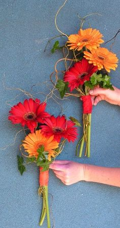 Yes! Berber daisies in fall colors maybe with a little burlap and twine wrapped around the middle  @Mary Powers Dransfield