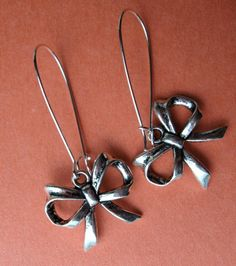 SILVER BOW EARRINGS on French wires. $7.00.   Tie yourself up in bows!