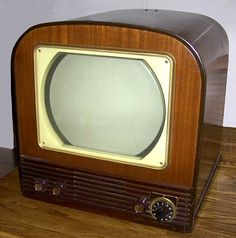 """Television provided endless hours of entertainment indoors & family life shifted from the porch to a family room or t.v. room, where families watched evening news, sporting events or early sitcoms, all while enjoying the newly invented """" tv dinner"""". No longer would families relax outside on the front porch. Photo is a 1950 Philco, Model T1403, 12 inch screen"""