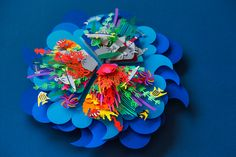 Colorful Layered Paper Cut Poster Depicting Ocean Pollution by Aline Houdé-Diebolt   Click through for full post.