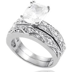 Alexandria Collection CZ Sterling Silver Bridal Set. Possibility for me.