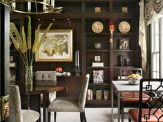 This room is a combination library/dining room. It features custom millwork designed by Jo Ann Alston for a bookcase, buffet and niche for a...