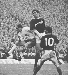 24th February 1968. England full back Ray Wilson does enough to put Scotland's John Hughes while Willie Johnston watches on.