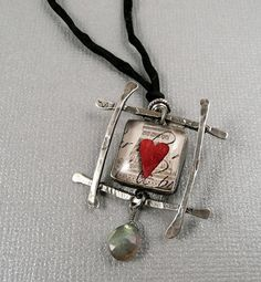 Sterling silver frame with heart in resin. @Mary Powers Powers Powers Lou McMullen has some lovely things :)