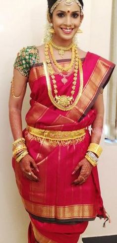 www.sameepam.com   South Indian bride. Temple jewelry. Jhumkis. Red silk kanchipuram sari.Braid with fresh jasmine flowers. Tamil bride. Telugu bride. Kannada bride. Hindu bride. Tamil Brahmin bride.Malayalee bride.Kerala bride.South Indian wedding
