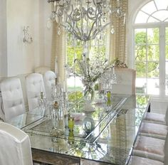 I love the monochromatic color scheme and all the sparkle from the abundance of natural light touching the glass/mirror table and crystal chandelier. Beautiful Dining Rooms, Beautiful Homes, Beautiful Interiors, Decoration Baroque, Beverly Hills Houses, Mirrored Furniture, Mirrored Table, Mirror Dining Table, Glass Table