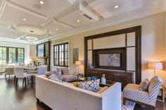 Sophisticated, comfortable dining and living room with coffered ceiling