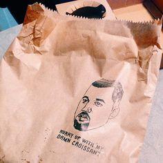 Kanye West Print on a croissant Brown Paper Bag.