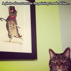 A photo of my cat next to the painting I made of him.