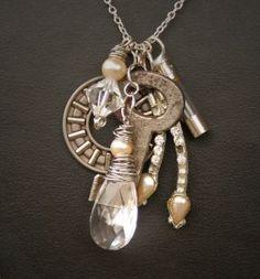 Romantic junk jewelry -  key, gear, fuse, chandelier crystal , a little silver bearing and rhinestone.