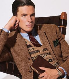 tweed jacket over sweater vest, watch on nato strap, one sharp dressed man