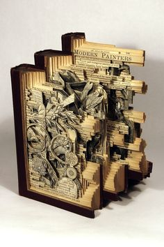 Using knives, tweezers and surgical tools, Brian Dettmer carves one page at a time. Nothing inside the out-of-date encyclopedias, medical journals, illustration books, or dictionaries is relocated or implanted, only removed. Dettmer manipulates the pages and spines to form the shape of his sculptures. He also folds, bends, rolls, and stacks multiple books to create completely original sculptural forms. He currently lives and works in Atlanta, GA.