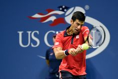 Novak Djokovic in action in a men's singles fourth-round match against Roberto Bautista Agut during the 2015 US Open.