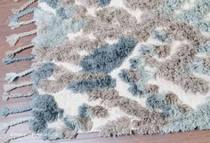 NEW: Mopel Rug (texture close up), a luxurious tribal style 100% wool hand-knotted rug with fringe detail in shades of  beige, brown, blue & grey (4 sizes) http://www.therugswarehouse.co.uk/traditional-rugs/knots-republic-rugs/mopel-rug.html