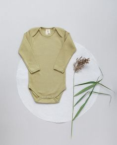 NEW - Fabric - 100% organic cotton, GOTS Ribbed-Jersey in VINTAGE-LOOK Soft - Stretchy - Breathable! Made with Love in EU. .  Baby-body featuring an envelope neck for easy dressing. The ribbed Jersey fabric in skin friendly organic quality allows it to stretch while always maintaining its shape and color. #babybasics #organicbyfeldman #sagegreen #salbei #newbornessentials #ribbedjersey #babybody #madeineu #vintagelook 📷 @ana.marchetanu