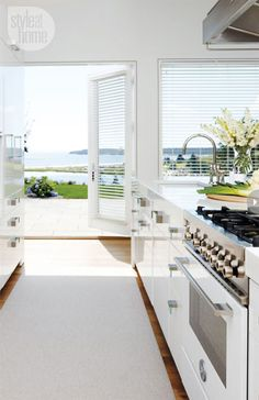 Love the idea of the kitchen having french doors off to the patio