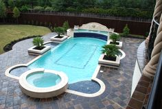 The awesome pool is outlined in Cantera Stone and surrounded by Antiqued-Manganese Saltillo Mexican tile. Custom made by Rustico Tile and Stone Backyard Projects, Backyard Patio, Outdoor Pool, Backyard Ideas, Hot Tub Surround, Pool Decks, Home Pictures, Cool Pools, Swimming Pools
