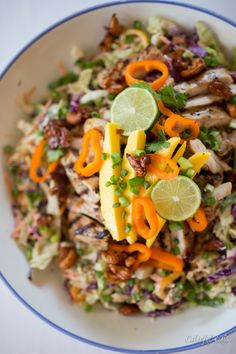 Gluten Free Paleo Thai Chicken Chopped Salad topped with deliciously spicy, crunchy cashews