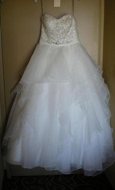 Maggie Sottero: buy this dress for a fraction of the salon price on PreOwnedWeddingDresses.com
