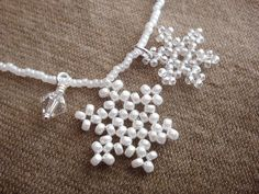Items similar to Snowflake Necklace, Snowflake Charm Necklace, Bridesmaid Necklace, Wedding Jewelry, Beaded with Seed Beads and Crystal - SALE on Etsy Bead Jewellery, Bead Earrings, Beaded Necklace, Snowflake Jewelry, Beaded Jewelry Patterns, Christmas Earrings, Bijoux Diy, Christmas Jewelry, Beads And Wire