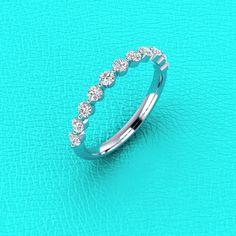 14K white gold single prong 0.60ct Diamond band by Masterjeweler, $600.00