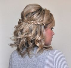 Combine your natural curls with braids to get this half-up braid updo for Valentine's Day with the help of this hair tutorial.