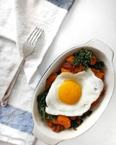 Simple sweet potato   kale  hash topped with a sunny side up egg  #healthyfoodporn