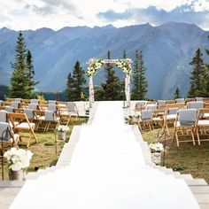 The ceremony was held at the Aspen Wedding Deck overlooking the Maroon Bells and the Rocky Mountains. A white aisle runner was laid over the steps leading down a rustic wedding arch.  Little Nell, CO