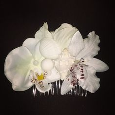 Heres a beautiful white tropical beach haircomb comb comes with little sea shell's...I can also add some iridescent glitter to the shells upon request.. this piece is selling for $12 plus shipping.  Leave email to purchase:) #deadlydinaaccessories #beachy #seashells #whiteorchids #tropical #hairflowers #hairaccessories #hairpiece#haircomb#summer