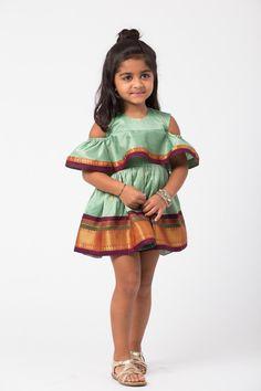 Navya - holiCHIC Silk cold shoulder sari dress in pistachio and maroon Estimated shipping: weeks Girls Frock Design, Baby Dress Design, Kids Frocks Design, Baby Frocks Designs, African Dresses For Kids, Latest African Fashion Dresses, Little Girl Dresses, Girls Dresses, Kids Dress Indian