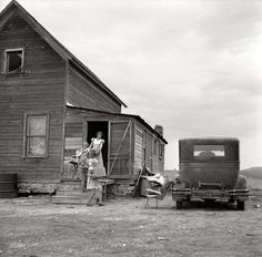 """""""Dust Bowl Farm Family."""" July 1936. Drought area of North Dakota. Family leaving drought-stricken farm for Oregon or Washington. (Medium-format nitrate negative by Arthur Rothstein for the Resettlement Administration.)"""