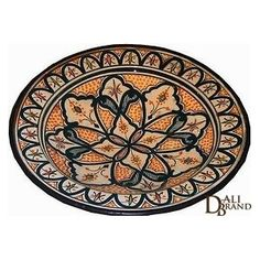 This beautiful plate has a typical moroccan drawing and design. Made by hand with terra-cotta and painted with vegetable oil, ideal for home decoration and can also be used to contain objects. Available in orange and teal.